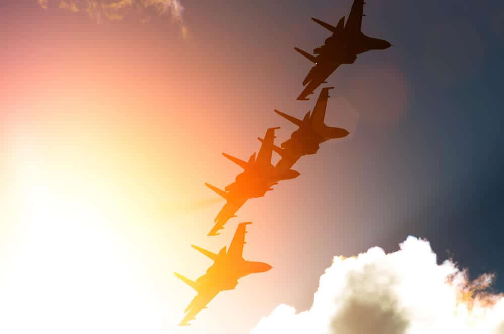 fighter jets against the background of sunbeams