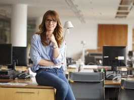 Redheaded Icelandic woman sitting in office