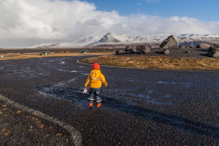 Toddler looking out at Icelandic landscape