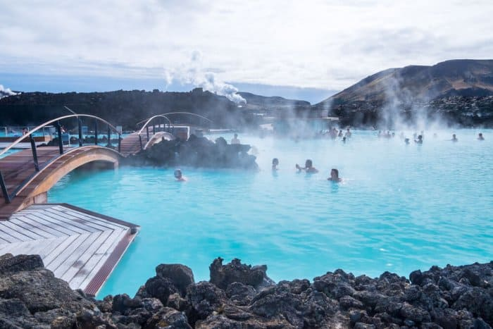People socializing in the famous blue lagoon the most famous Iceland's Geothermal Baths