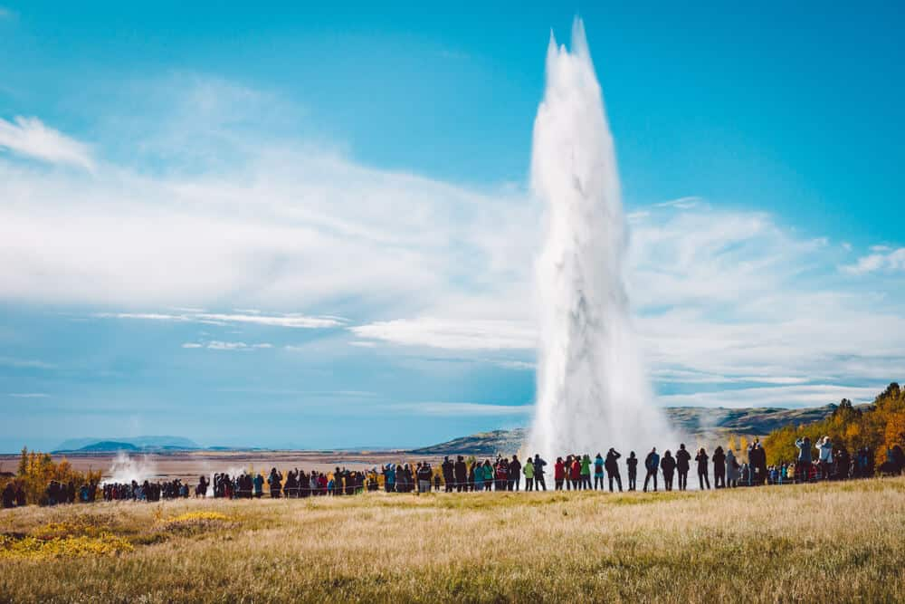 Geysir with a group of visitors,once of iceland's main tourist destination