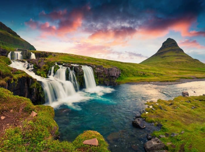 Kirkjufellsfoss at sunset with Kirkjufell mountain in the background