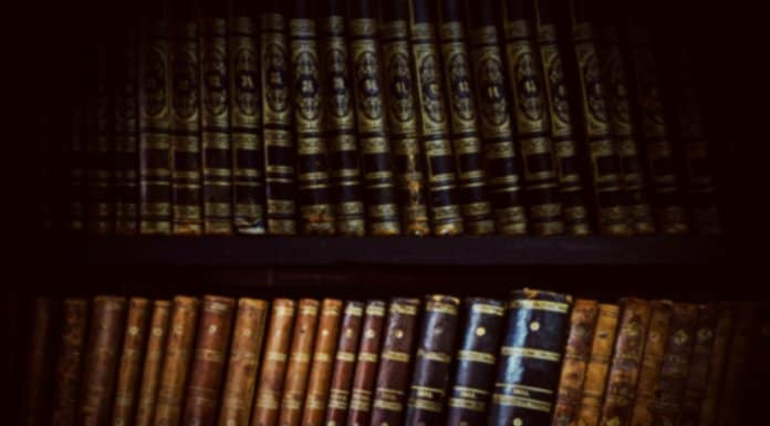 Open book in old-fashioned library chronicling Icleand's history