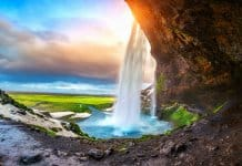 Seljalandsfoss at sunset is one of Iceland's most beautiful waterfalls