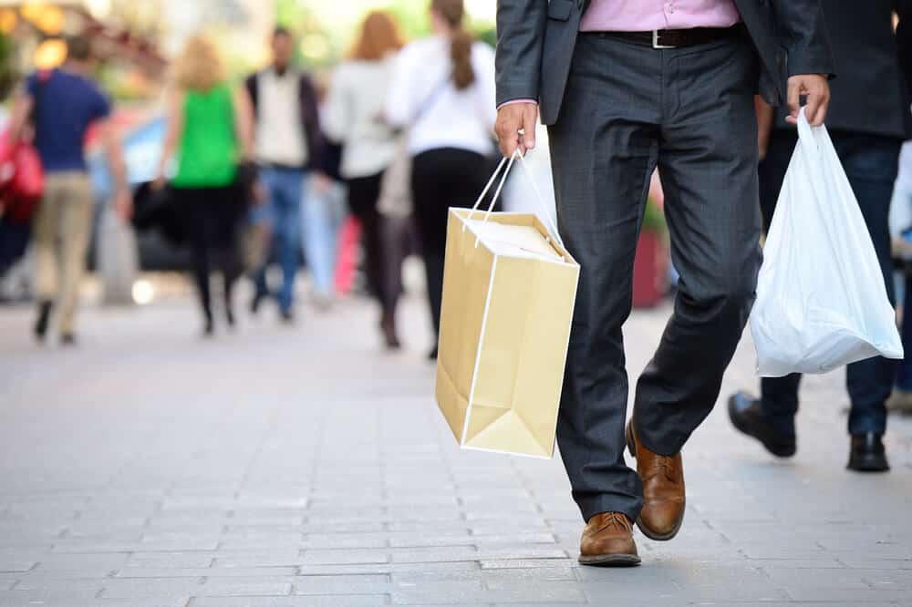 Man shopping walking down street like Laugavegur in Reykjavik