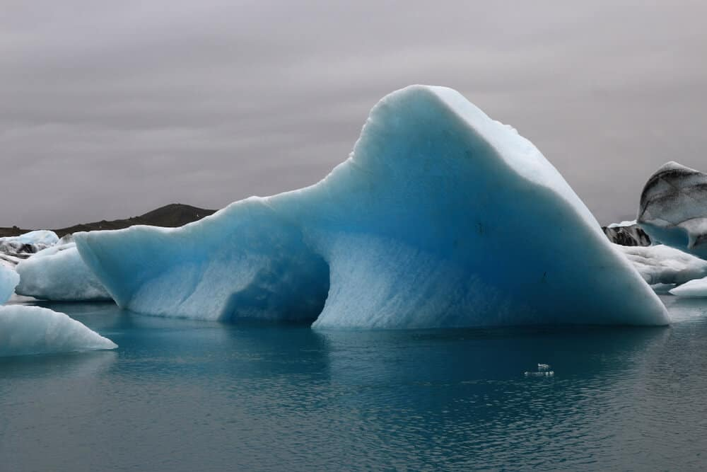 An small iceberg floating in the Jókulsárlón glacier lagoon, one of the top five things to do in Iceland