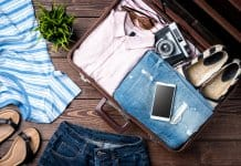 Open suitcase with items on the Iceland summer packing list