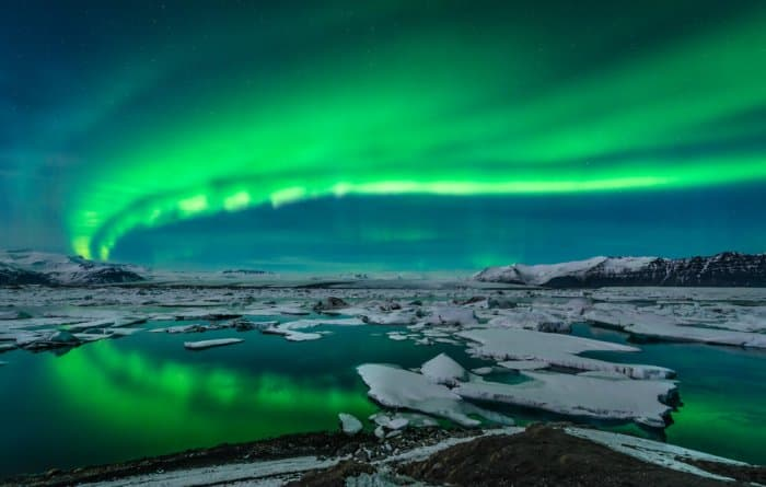The Northern Lights dancing over Jokusarlon glacier lagoon