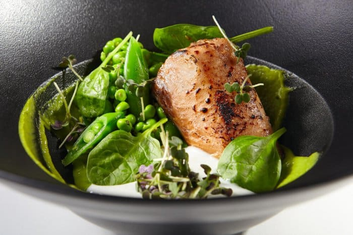 Reykjavik's best restaurants have many fish options like this grilled salmon with greens