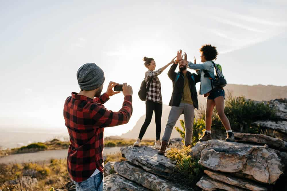 Friends taking pictures at Godafoss for Instagram