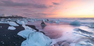 Jökulsárlón Glacier Lagoon at dawn with a beautiful purple light