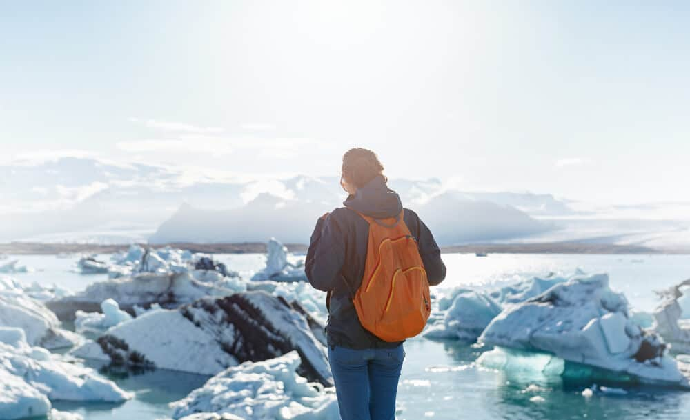 Girl with a light backpack, it is a must in our Packing Guide For Reykjavik