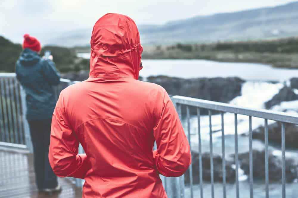 Girl on a red rain coat in Iceland