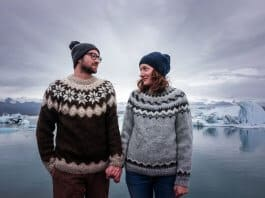 A couple of young icelanders wearing the traditional sweater of the icelandic culture