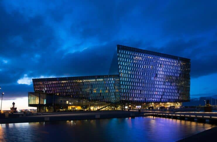Harpa Concert Hall lit up at night during 24 hours in Reykjavik