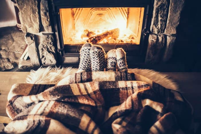 Nothing's cozier than a blanket, warm socks, and a fireplace during your road trip to Iceland