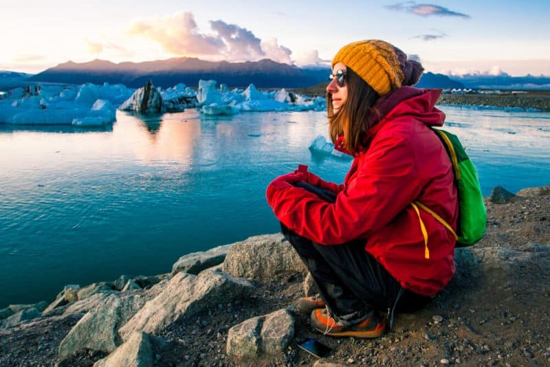 Tourist in cold weather in November at Iceland's glacier lagoon