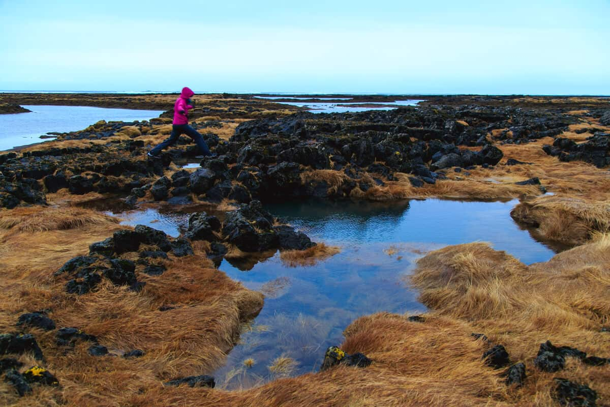 Woman running on Icelandic moss