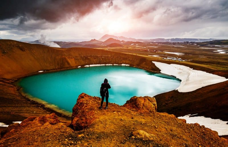 Tourist standing at the edge of Krafla in Iceland