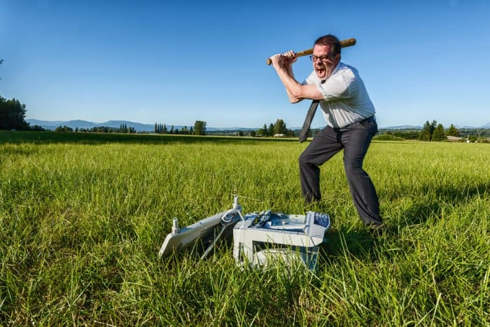 Tourist destroying Icelandic vegetation along with a computer
