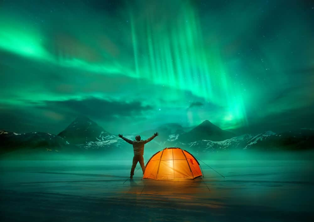 Man admiring Northern Lights during Iceland in November. Is it cold?