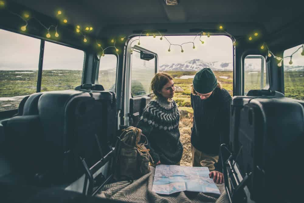 Couple deciding on Iceland itienerary with their campervan rental