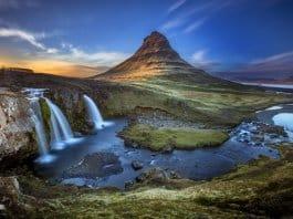 Kirkjufell Mountain and Kirkjufellsfoss Waterfall at sunset in Snaefellsnes peninsula