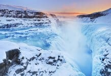 Winter travel tip with frozen Gullfoss waterfall