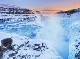 Winter travel tip with frozen Gullfoss waterfall