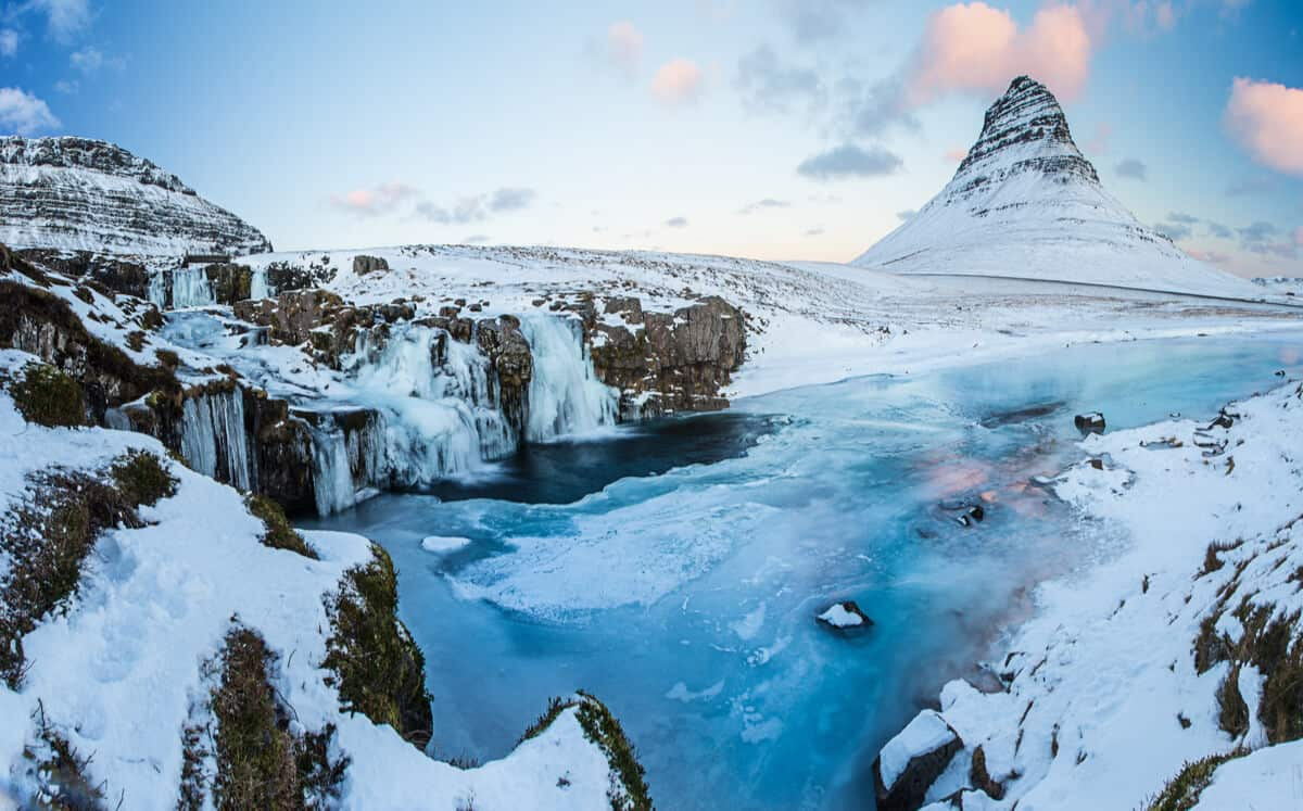 Snow covered landscapes at Kirkjufell mountain and Kirkjufellsfoss waterfall in Snaefellsnes peninsula