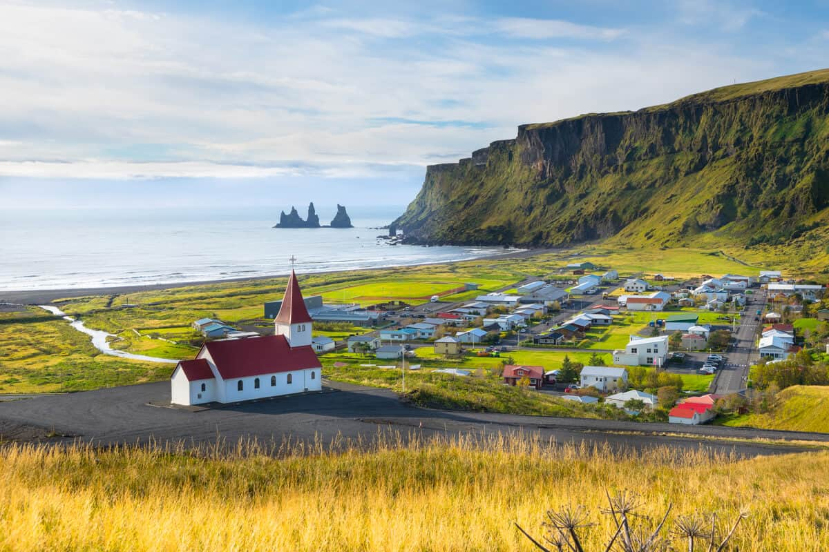 View of coast with Vik church in South Iceland
