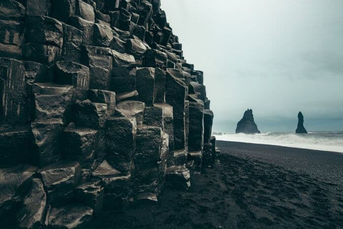 Reynisfjara black sand beaches and basalt columns are Vik's signature natural attraction
