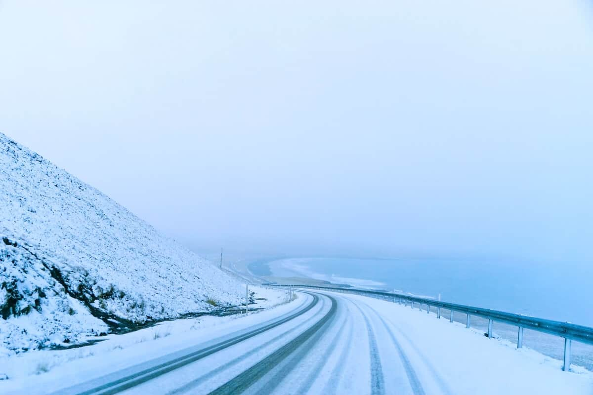 Snowy road conditions in Iceland during a storm