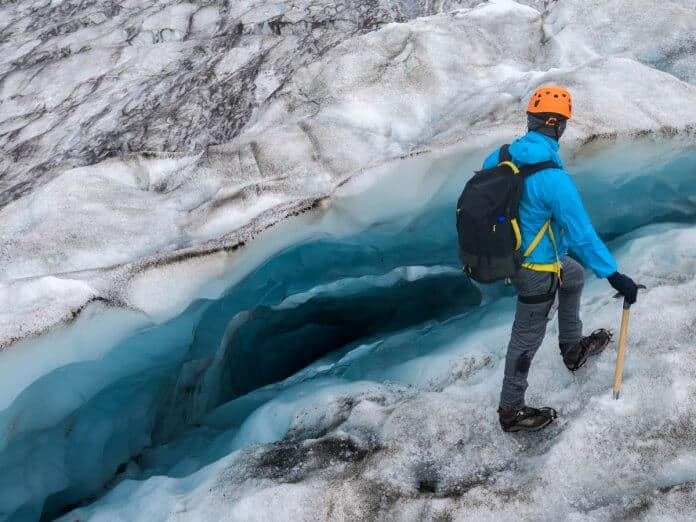 Man hiking on an Iceland glacier close to the crevice