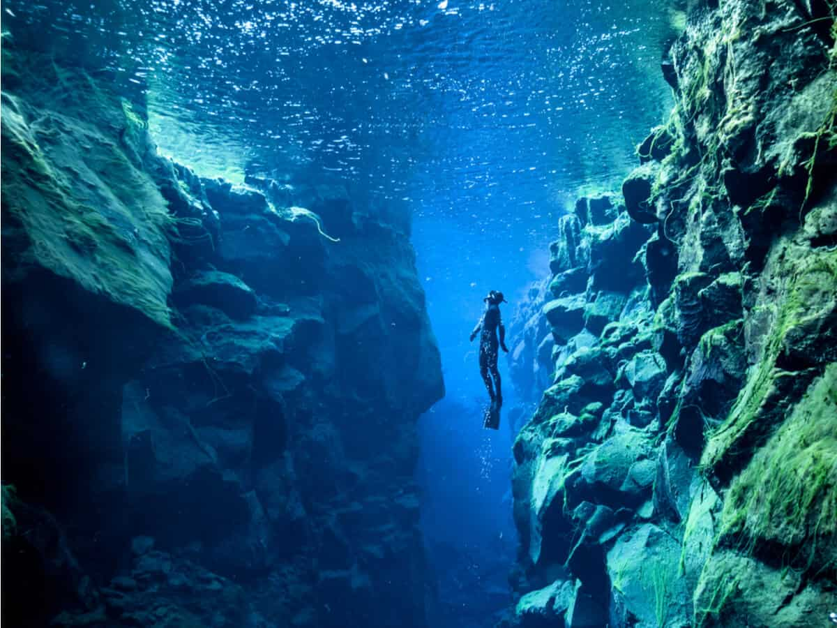 Scuba diving in the Silfra Fissure is a luxury travel activity in Iceland