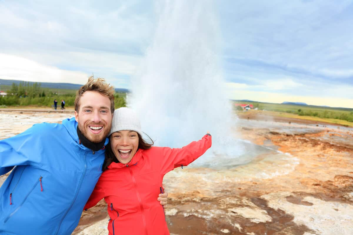 Iceland honeymoon couple at geyser