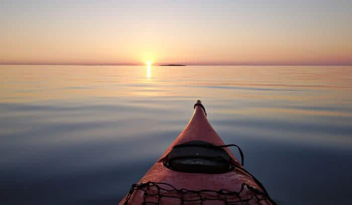 Sea kayak viewing the midnight sun in Iceland