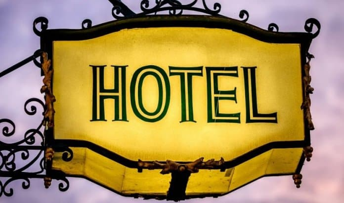 Sign for luxury hotels lit up