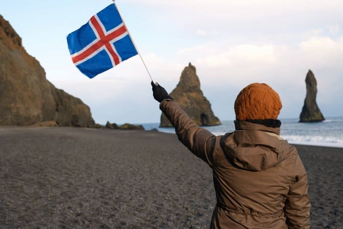 Girl waiving a flag on Iceland's Independence Day