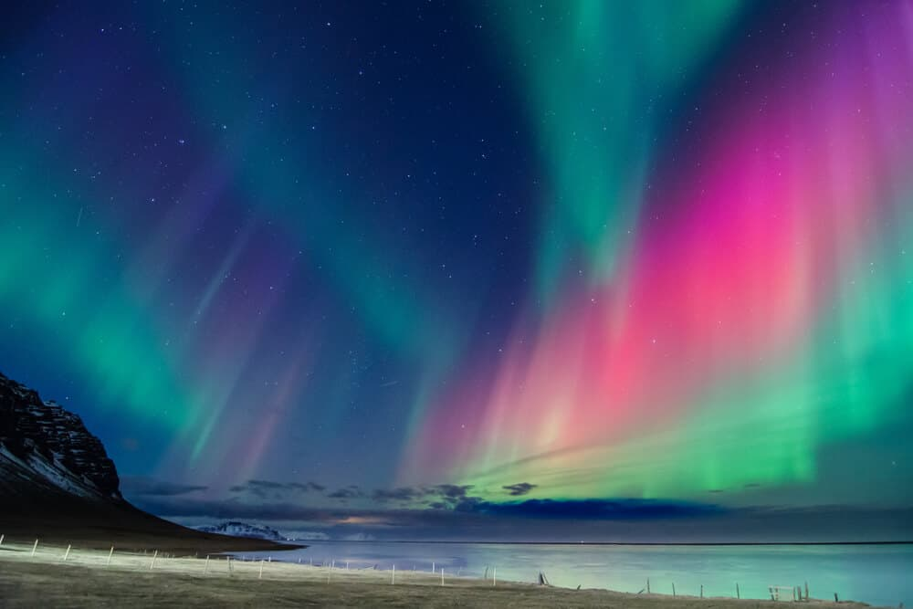 The Northern Lights in Iceland with pink, green, purple, and blue
