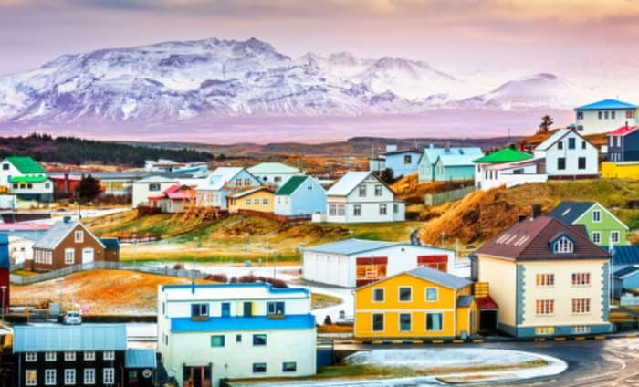 Icelandic town with mountain in the background