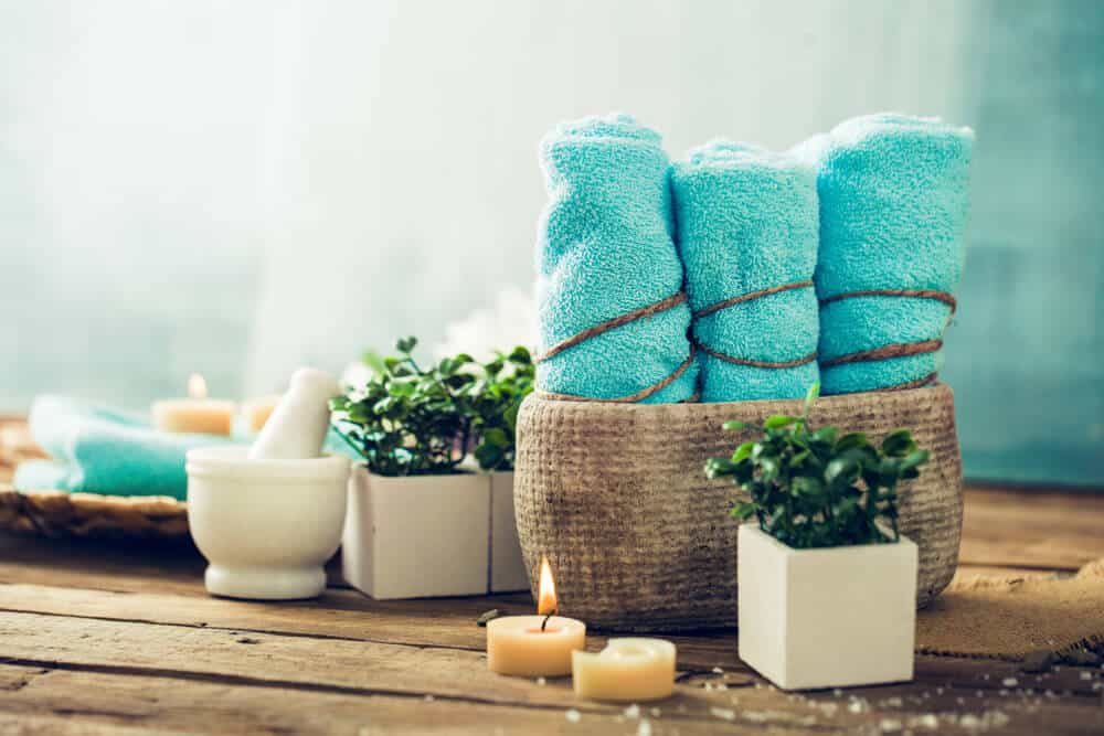 Blue spa towels, candles and plants