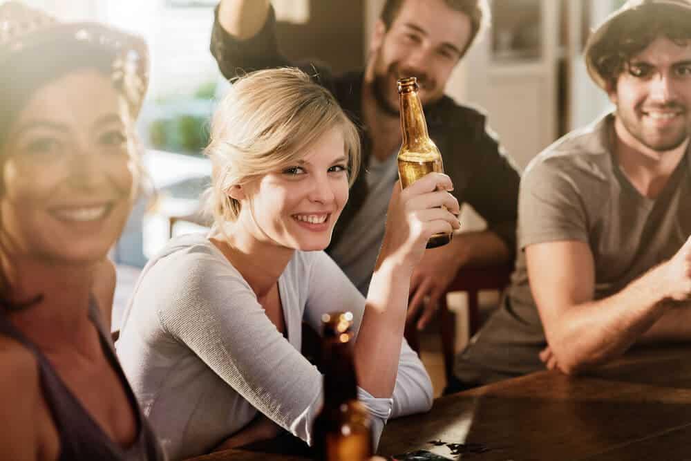 Friends meeting in Bars in Reykjavik while drinking beer