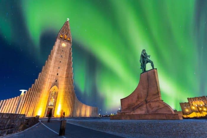 The Northern Lights illuminate Hallgrímskirkja during 24 hours in Reykjavik