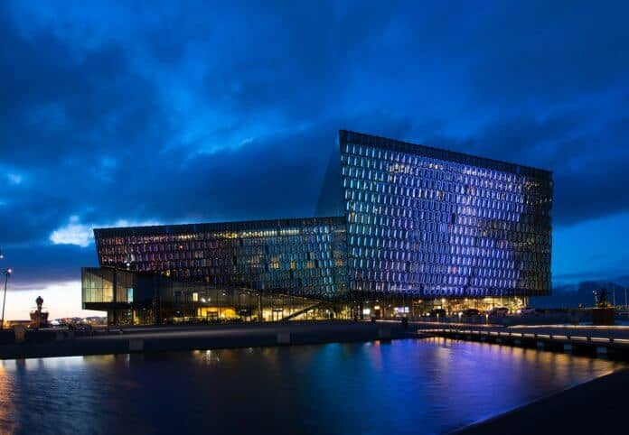 Harpa Concert Hall lit up at night during 24 hours in Reykjavik