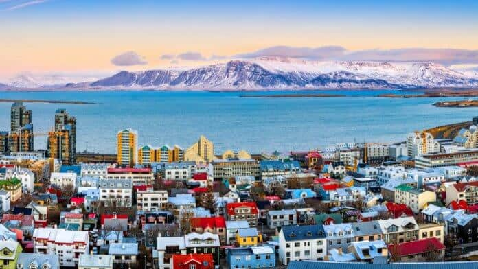 Reykjavik with water and mountains in the distance during 24-hour stopover