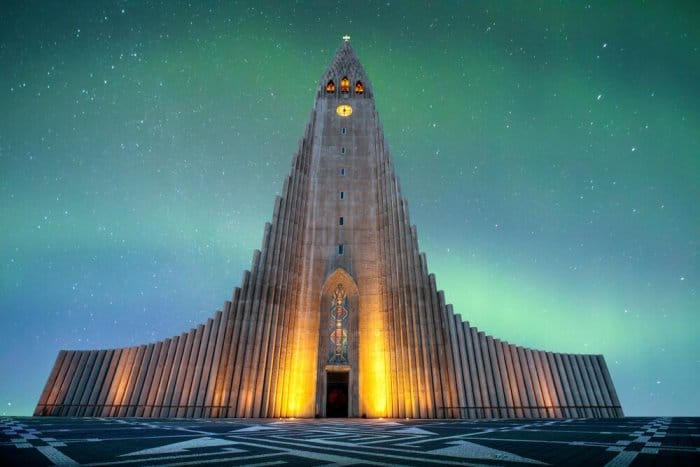 Hallgrímskirkja during the Northern Lights is a must-do for sightseeing in Reykjavik