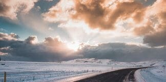 Sun's rays bursting through winter clouds on Iceland road trip