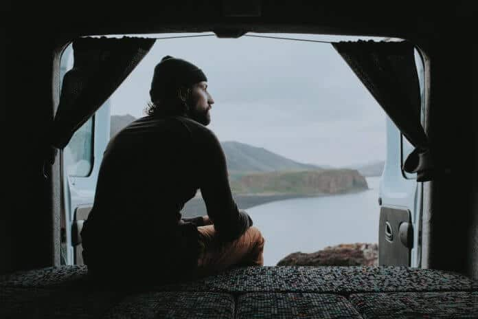 Man looking out from his Iceland campervan rental
