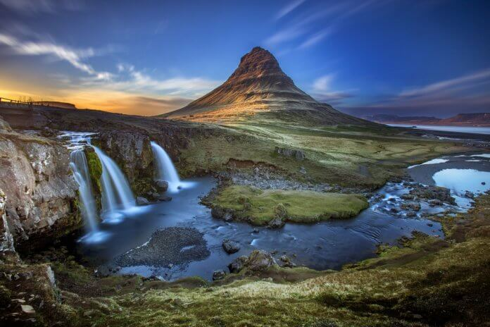 Kirkjufell Mountain and Kirkjufellsfoss Waterfall at sunset in Snaefellsnes peninsula